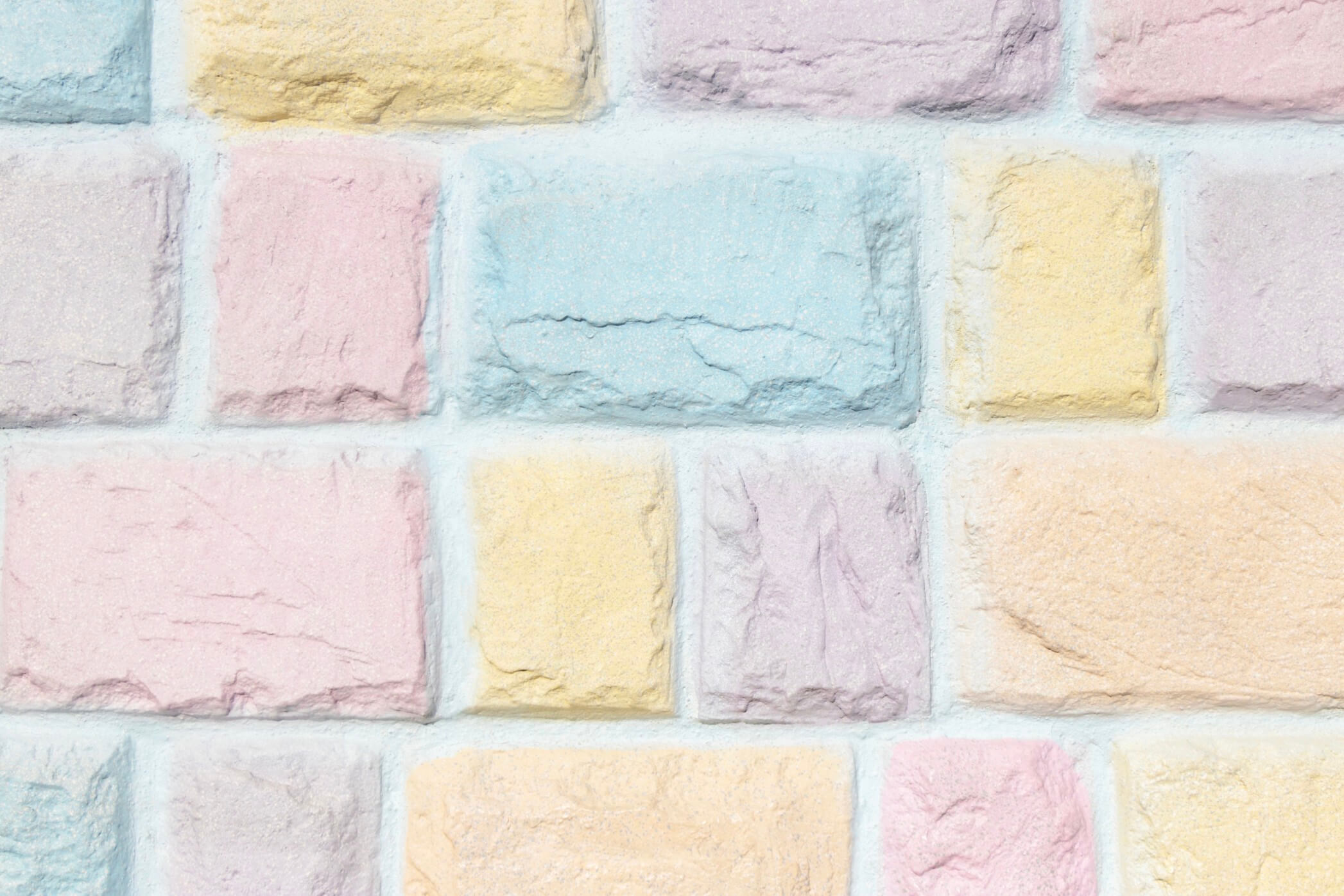 colorful-pastel-brick-wall-texture-background-pink-yellow-orange-purple-and-blue_t20_LO6dZK